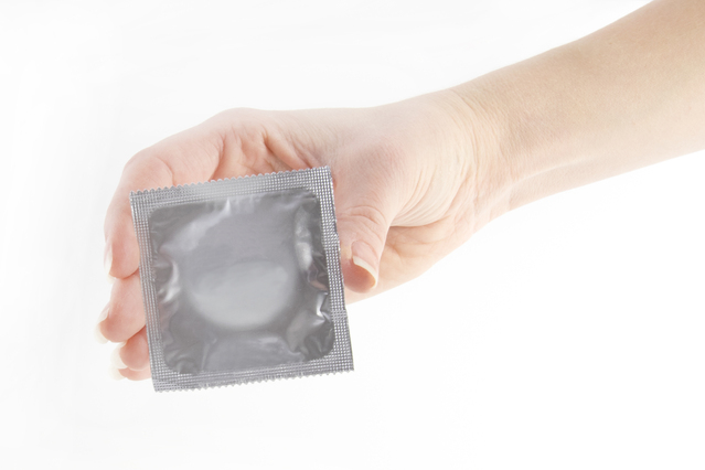 condom-in-the-hand-on-white-photos-1243973-639x425